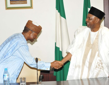 VICE-PRESIDENT NAMADI SAMBO (R), IN A HANDSHAKE WITH THE CHAIRMAN, TANSMMISSION COMPANTY OF NIGERIA (TCN), MR IBRAHIM  WAZIRI, AT A MEETING AT THE PRESIDENTIAL VILLA IN ABUJA.