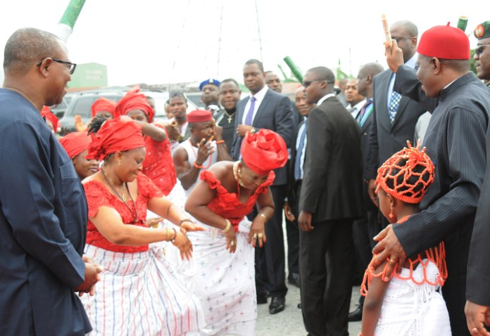 PRESIDENT GOODLUCK JONATHAN (R), ACKNOWLEDGING TRADITIONAL DANCERS HERALDING HIS ARRIVAL FOR THE GROUND BREAKING CEREMONY FOR  SECOND NIGER BRIDGE IN ONITSHA.