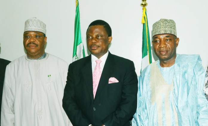 FROM LEFT: MINISTER OF WORKS, MR MIKE ONOLEMEMEN;  GOV. WILLIE OBIANO OF ANAMBRA AND PERMANENT SECRETARY, MINISTRY OF WORKS, ALHAJI  ABUBAKAR MOHAMMED, DURING THE GOVERNOR'S VISIT TO THE MINISTRY IN ABUJA ON THURSDAY (27/3/14).