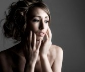 6594395-powerful-shot-of-a-vulnerable-lady-against-grey-background
