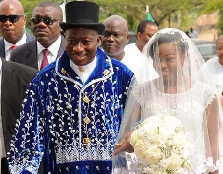 PRESIDENT GOODLUCK JONATHAN WALKING INTO THE CHURCH WITH HIS DAUGHTER, FAITH, DURING THE WEDDING HIS DAUGHTER TO GODSWILL IN ABUJA ON SATURDAY (12/4/14).