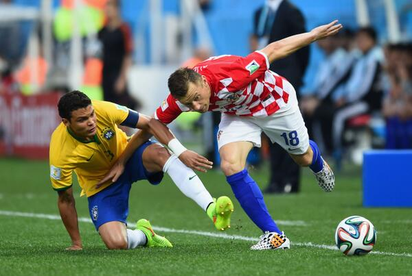 Fred Struggles for the Ball With a Croatian Opponent During the Opening Game of the 2014 World Cup. Getty Image.
