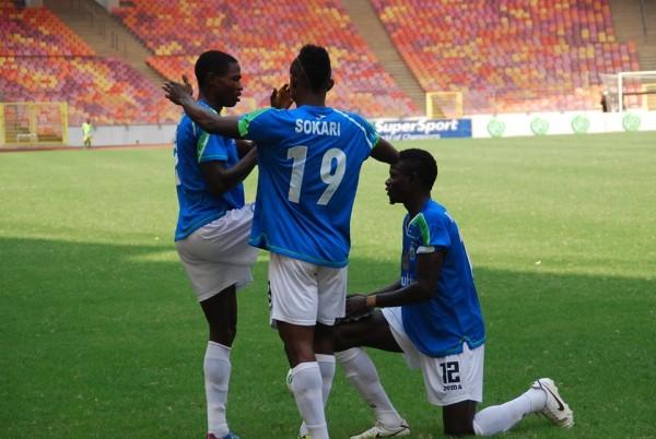 Kingsleyb Sokari Celebrates With Abdulrahama Bashir During a Pre-Season Match in Abuja.