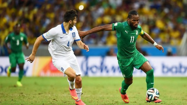 Didier Drogba Fends  Off the Challenges of Greece Defender Konstantinos Manolas During Ivory Coast's Final Group Game at the 2014 World Cup. Getty Image.