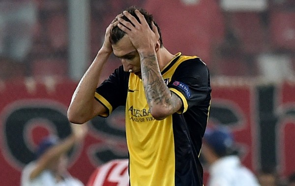Mario Mandzukic Broke His Nose During Atletico's 3=2 Loss at Olympiakos. Image: ARIS MESSINIS/AFP/Getty Images