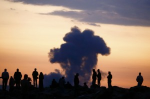 Turkish Kurds watch the smoke rises from Syrian town of Kobani near the Mursitpinar border crossing, on the Turkish-Syrian border