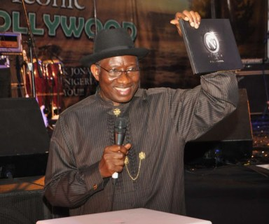 PRESIDENT GOODLUCK JONATHAN PRESENTING THE ICON OF NOLLYWOOD PHOTO BOOK AT THE EVENT