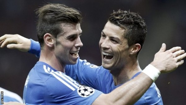 Gareth Bale celebrates With Teammate Ronaldo After the Portuguese Scored From His Free-Kick.