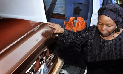 SOLOMON LAR'S WIDOW TOUCHING THE COFFIN CONTAINING HIS REMAINS