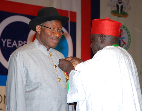 NATIONAL CHAIRMAN, NIGERIAN LEGION, RETIRED COL. MICAH GAYYA (R), DECORATING PRESIDENT GOODLUCK JONATHAN WITH THE EMBLEM FOR THE 2014 ARMED FORCES REMEMBERANCE DAY CELEBRATION IN ABUJA ON MONDAY (16/12/13).