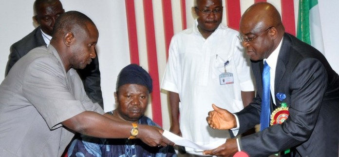 PRESIDENT OF ASUU, DR ISA FAGGE (L), PRESENTING SIGNED AGREEMENT BETWEEN ASUU AND FG TO THE SENATE PRESIDENT DAVID MARK, DURING ASUU LEADERSHIP VISIT TO THE SENATE  IN ABUJA LAST MONTH (NAN).