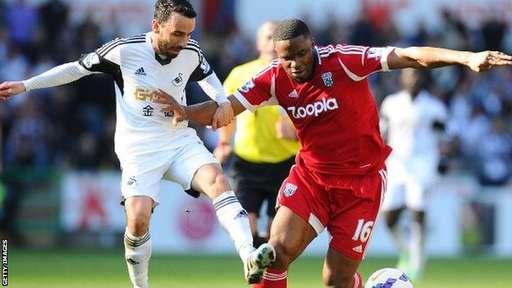 Swansea's Leon Britton Challenges Victor Anichebe in a League Match Last Weekend.