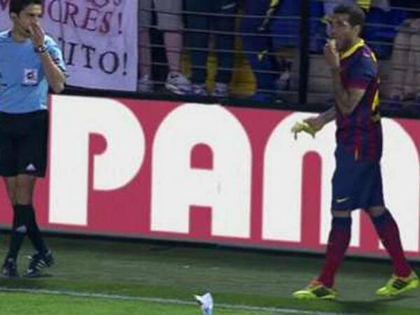 Dani Alves Bites Banana Thrown at Him During Barcelona's 3-2 Win Over Villareal.