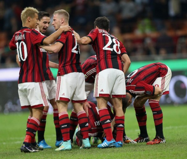 Sulley Muntari Surrounded By Milan Team-Mate After Opener. Image: Getty.