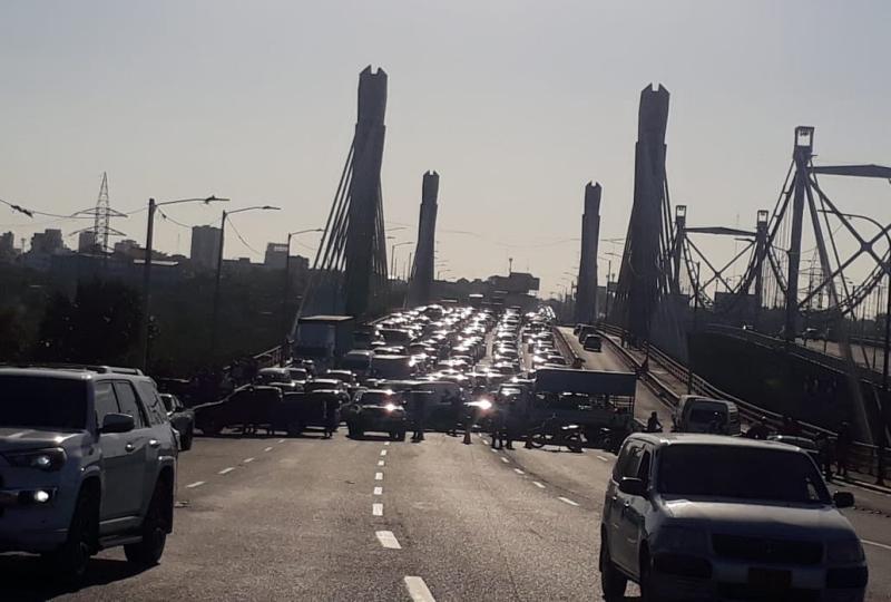 Cierran el angostura desde Ángel Domingo Oriente cerca de el Intramuros Doméstico por el puente Juan Bosch – .