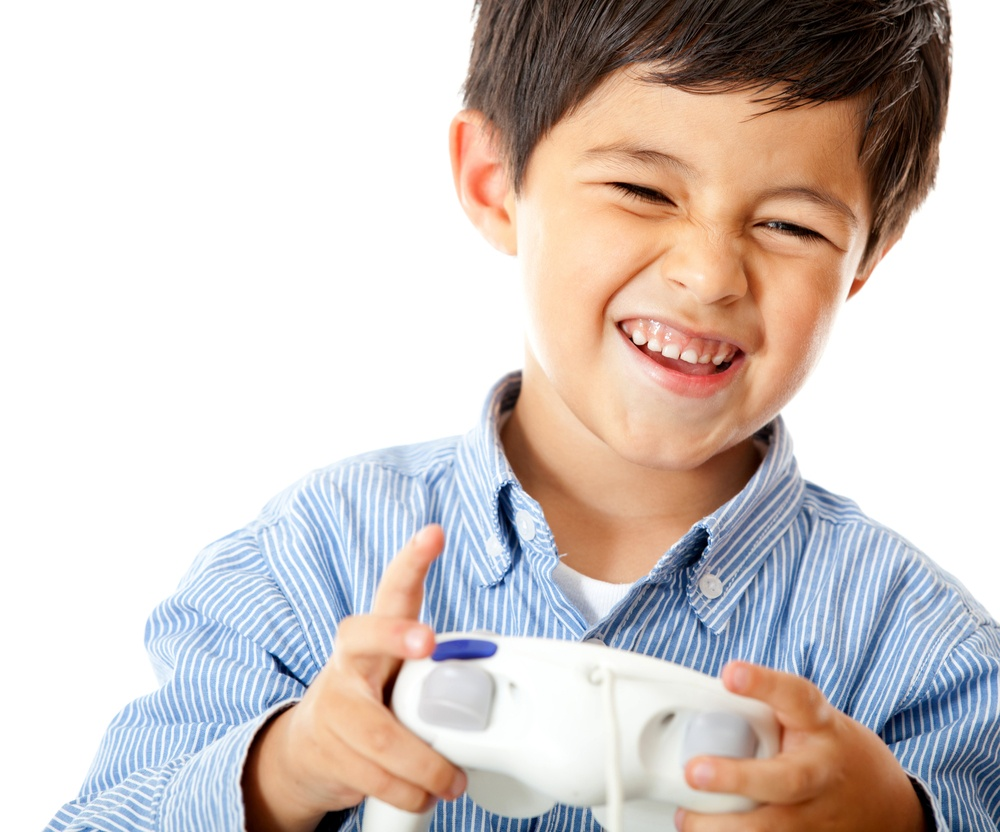 Boy playing video games holding a control - isolated over a white background 2