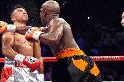 Mayweather-vs-Ortiz-punch