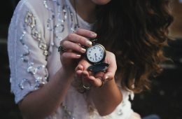 woman holding watch