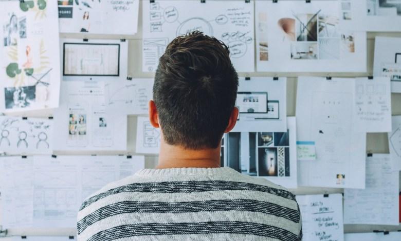 man looking at storyboard
