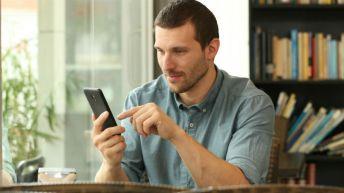 man looking at mobile phone