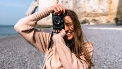 woman smiling taking pictures