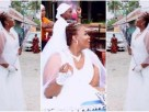 """VIDEO: """"I have money, pls marry me"""" -lady hits the streets in wedding gown to look for a husband"""