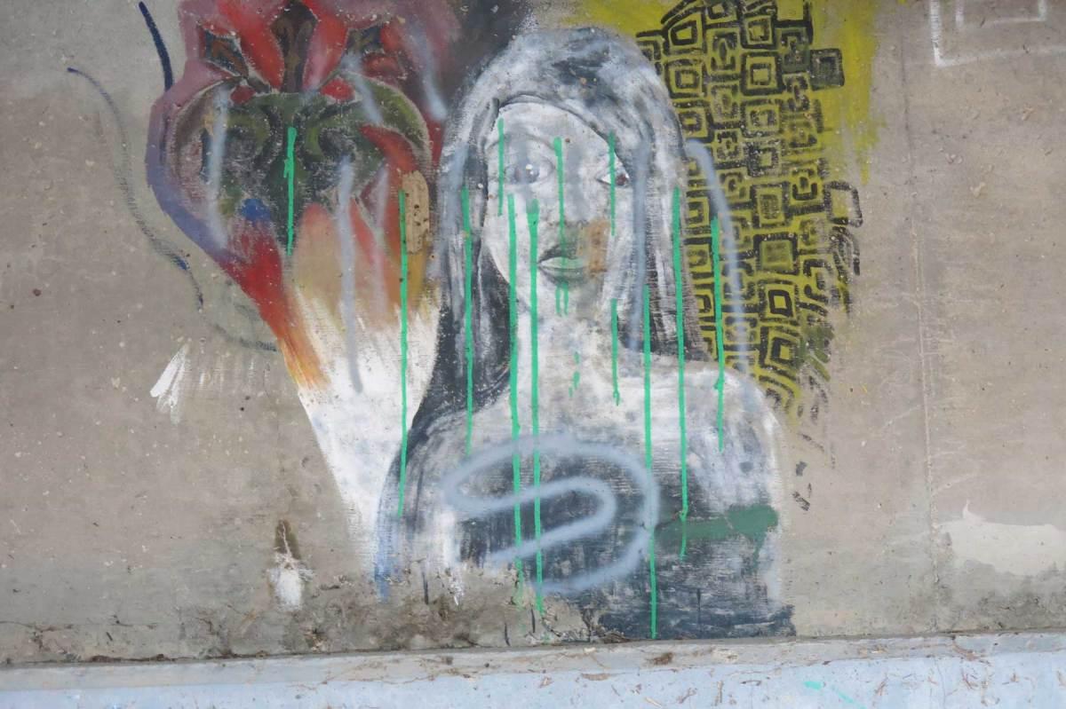 Interesting graffiti under a bridge deck in Ohio.