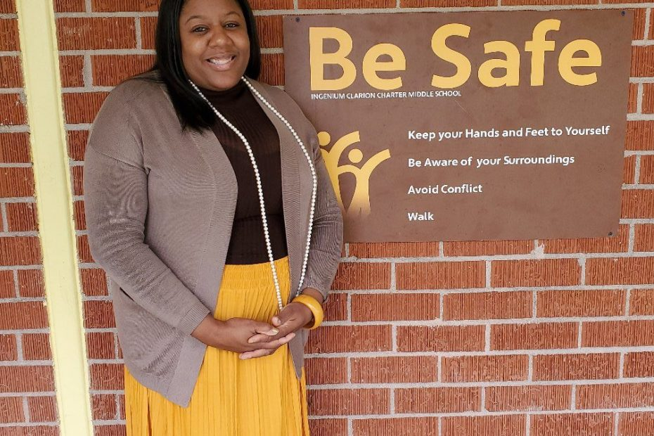 "ICCMS student standing in front of a ""Be Safe"" Sign"