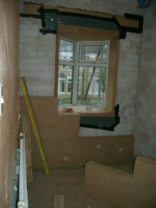 Draught proofing around the bay. Thinner 40mm insulation boards on the window reveals.