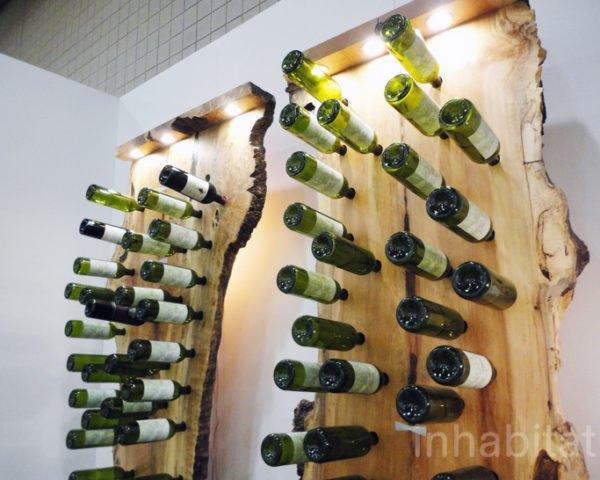 fallen tree wine rack holds a wine