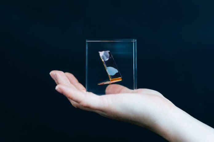 Person holding glass cubes