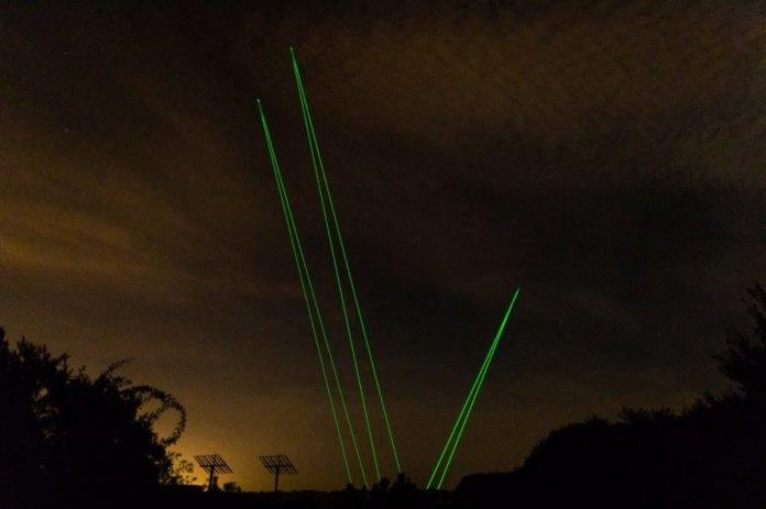 green laser lights in a dark sky