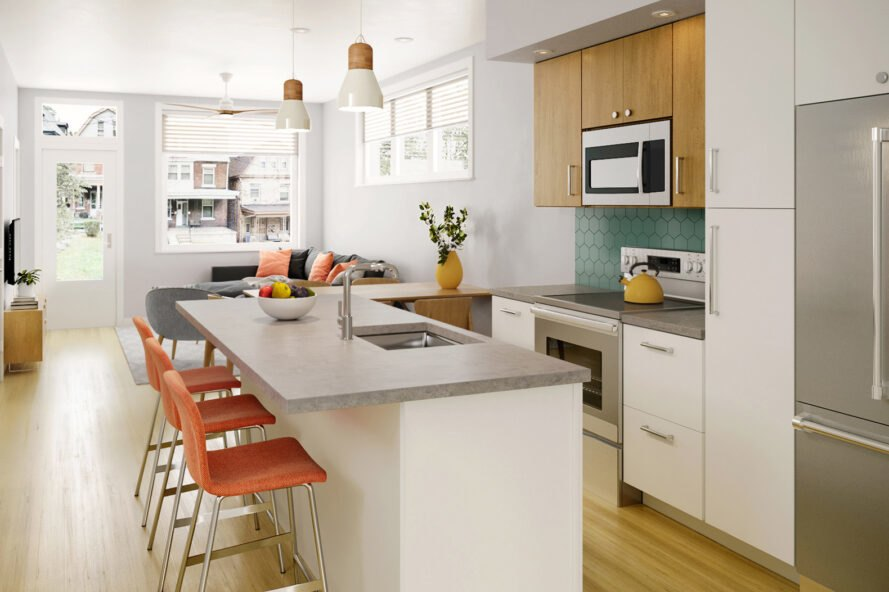 a kitchen with three orange bar stools sat at an island in the kitchen. two light fixtures hang from the ceiling.