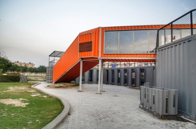 orange shipping containers with large glass windows