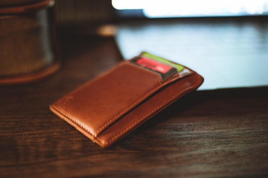brown wallet on a wood table