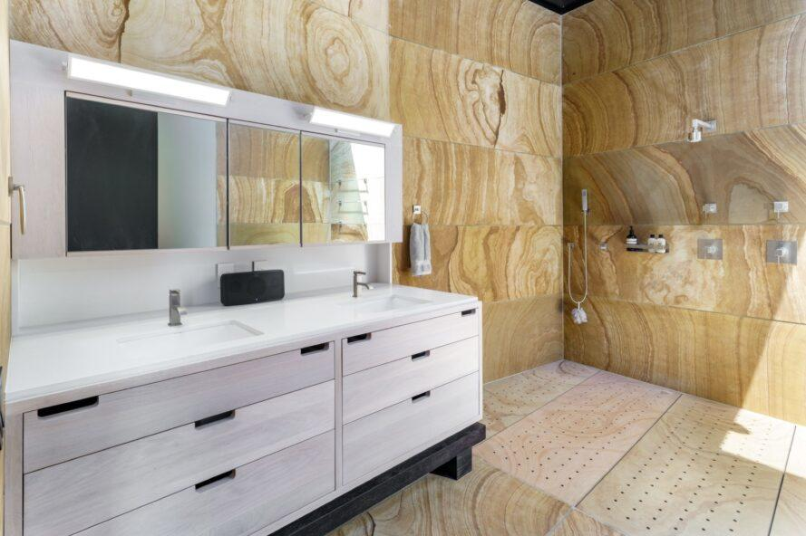 bathroom with wood walls and white vanity