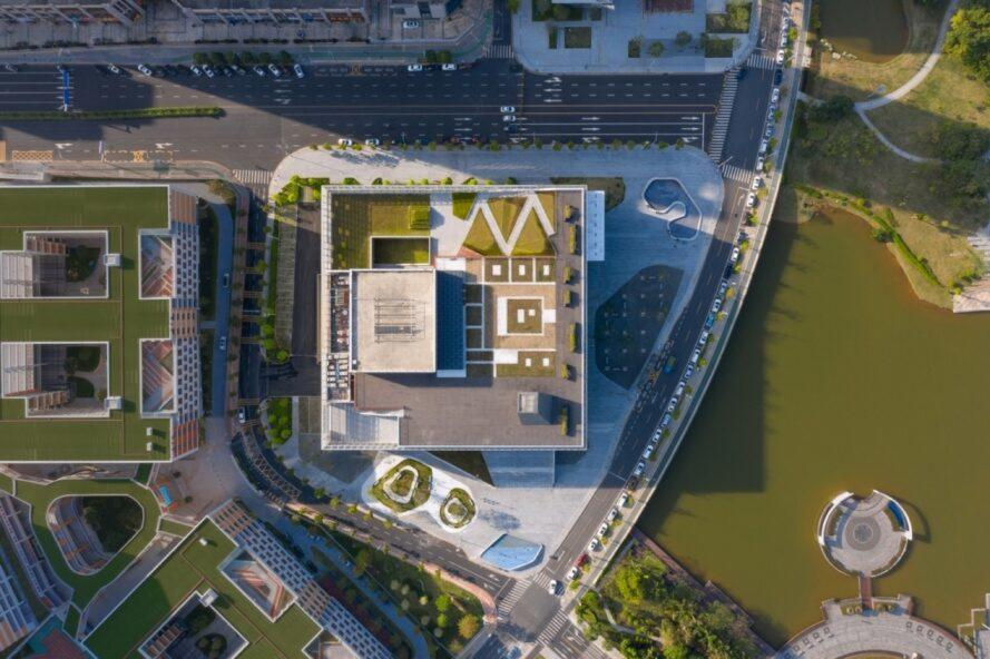 large white and blue theater building with rooftop gardens