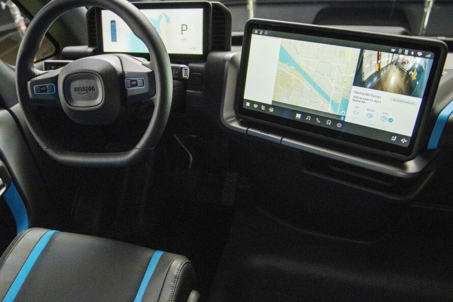 digital screens with maps in an electric van