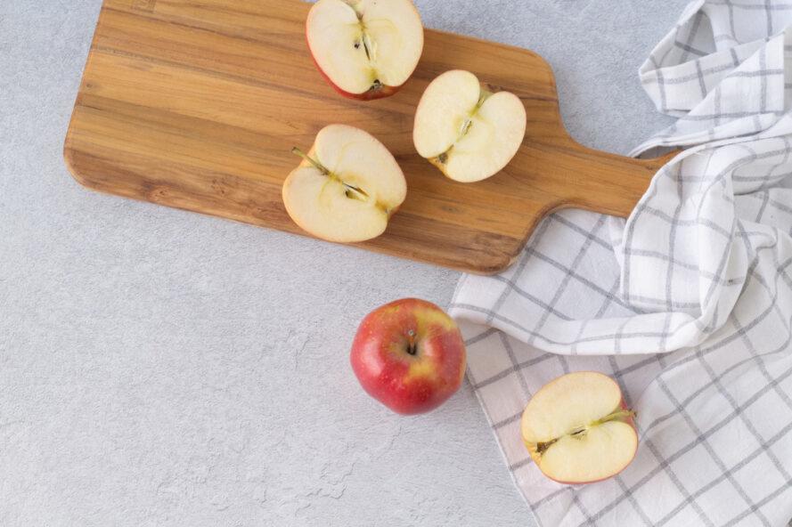 cut apples on wood board
