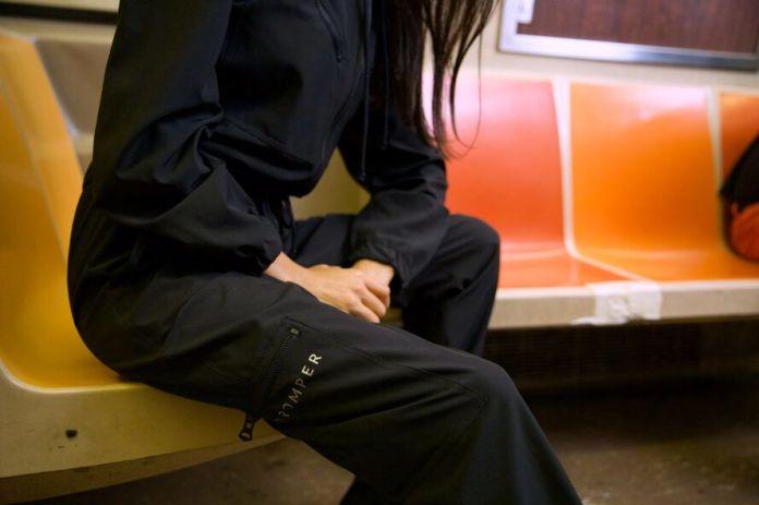 person sitting on subway while wearing BioRomper