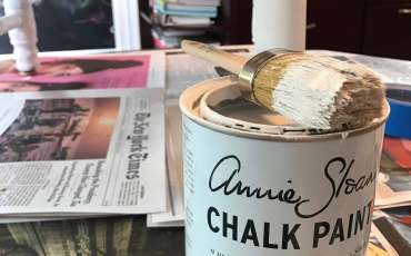 "A pot of Annie Sloan paint in ""Pure White""."