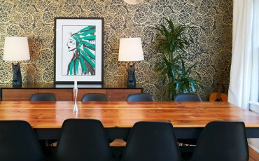 Stunning gold and black wallpaper compliments a custom made painting by a new York City artist in Alexis' favorite pop color, green.