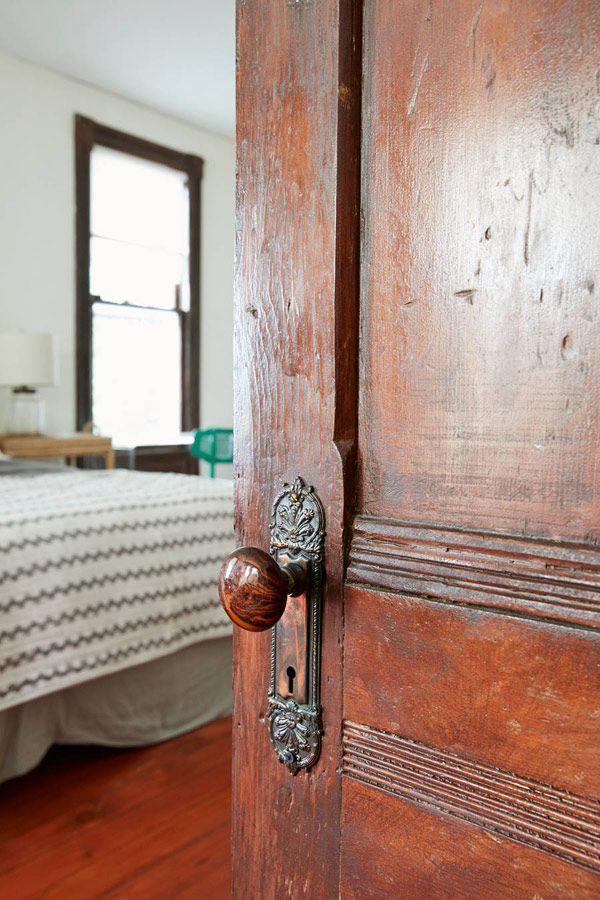 Jess Davis, owner of Nest Studio, original wooden door to the master bedroom in her South Orange NJ Victorian