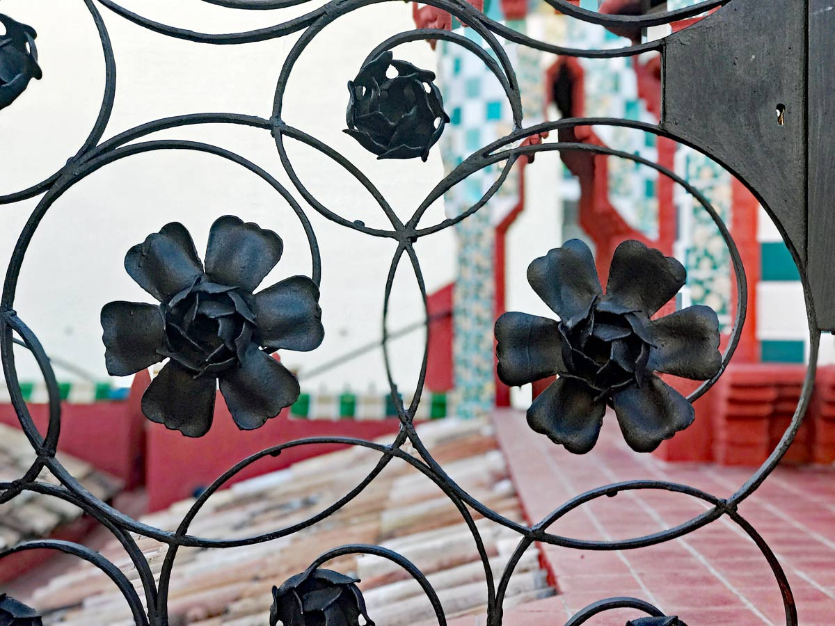 ornate metal gate on the rooftop of Gaudi's Vicen Home in Barcelona, Spain.s