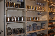 Metal teapots lined up