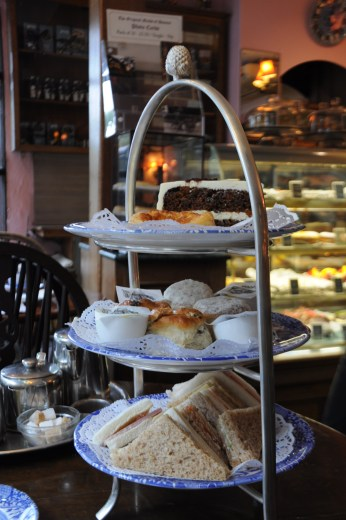 Stand of sandwiches, cakes and scones