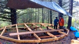 A tarp flown over the yurt platform to shield the work-space and materials from the rain.