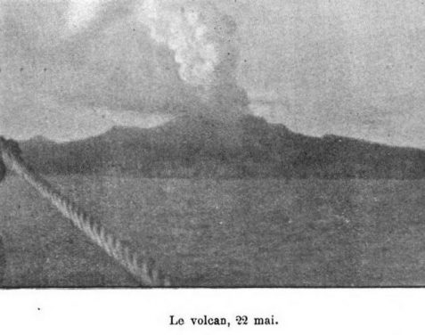 1902 photo of boat approaching smoking Mount Pelee