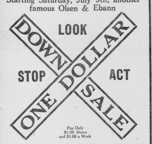 Newspaper advertisement for sale railroad crossing sign imagery