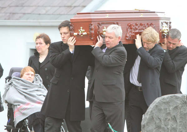 The remains of the late Tom Gilmartin are carried to his Urris grave on Tuesday morning as his wheelchair-bound wife Vera looks on. (Photo: NewspixIrl)